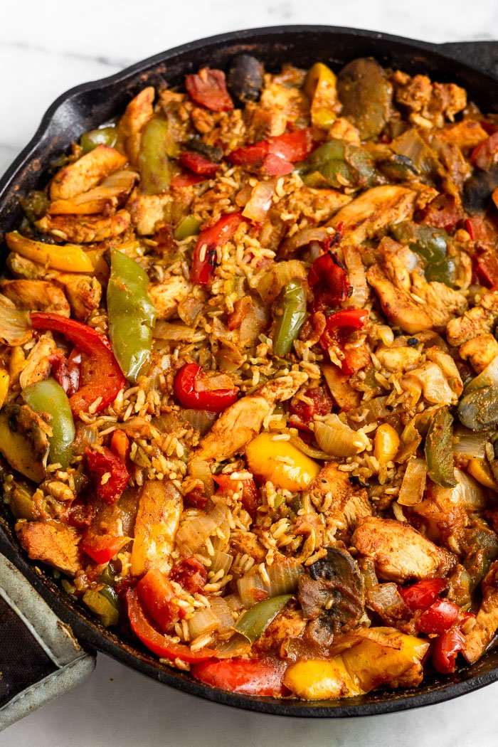 Baked chicken fajita casserole in a large cast iron.