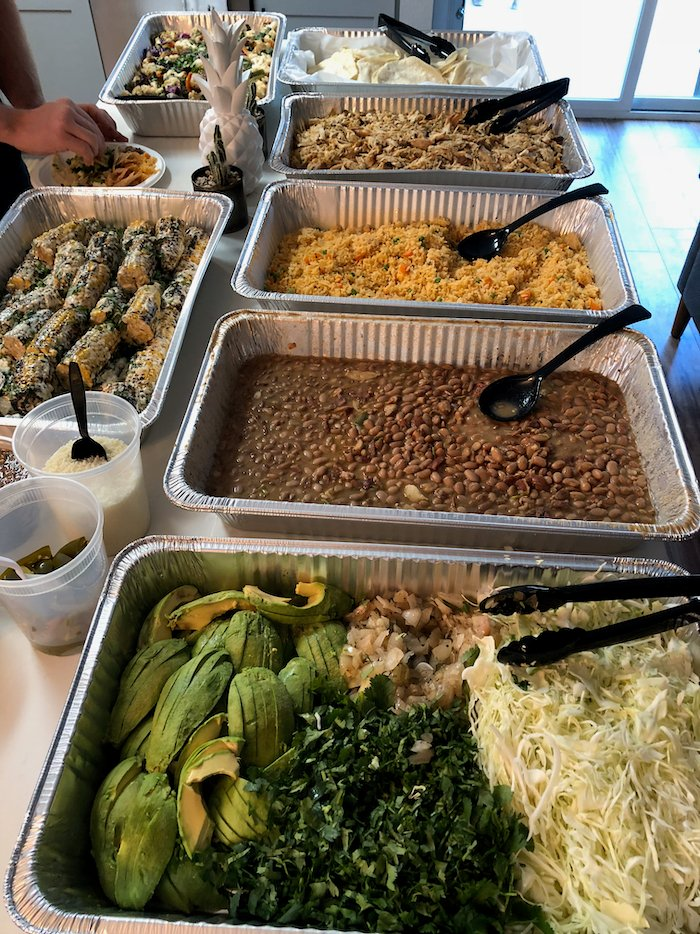 Buffet of Mexican food on a counter.