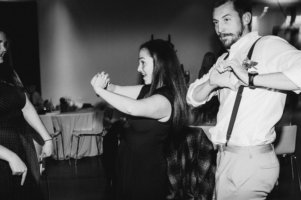 "Guy and a girl dancing to ""God's Plan"" by Drake at a wedding."