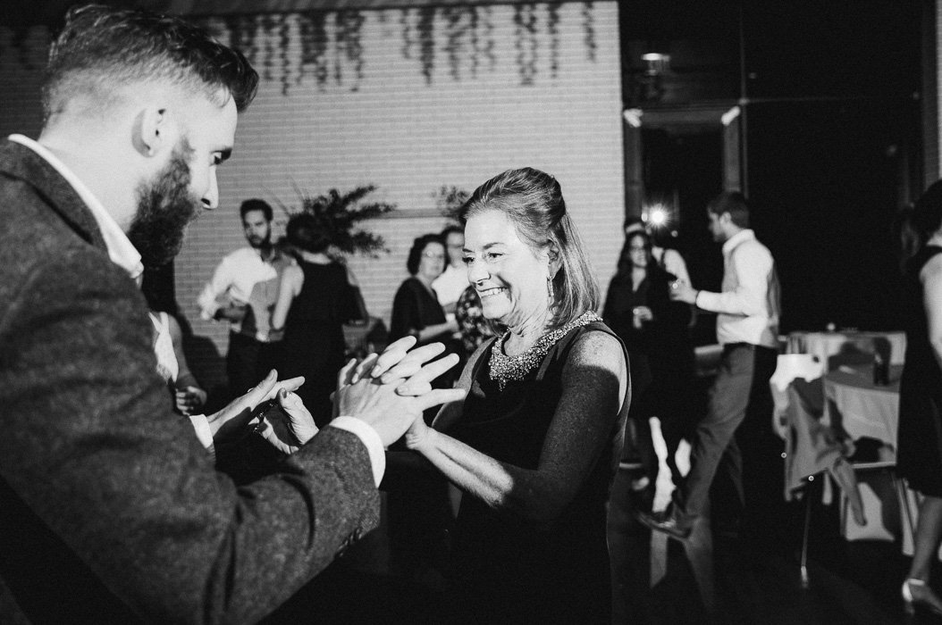 Groom and his mother-in-law dancing at a wedding.