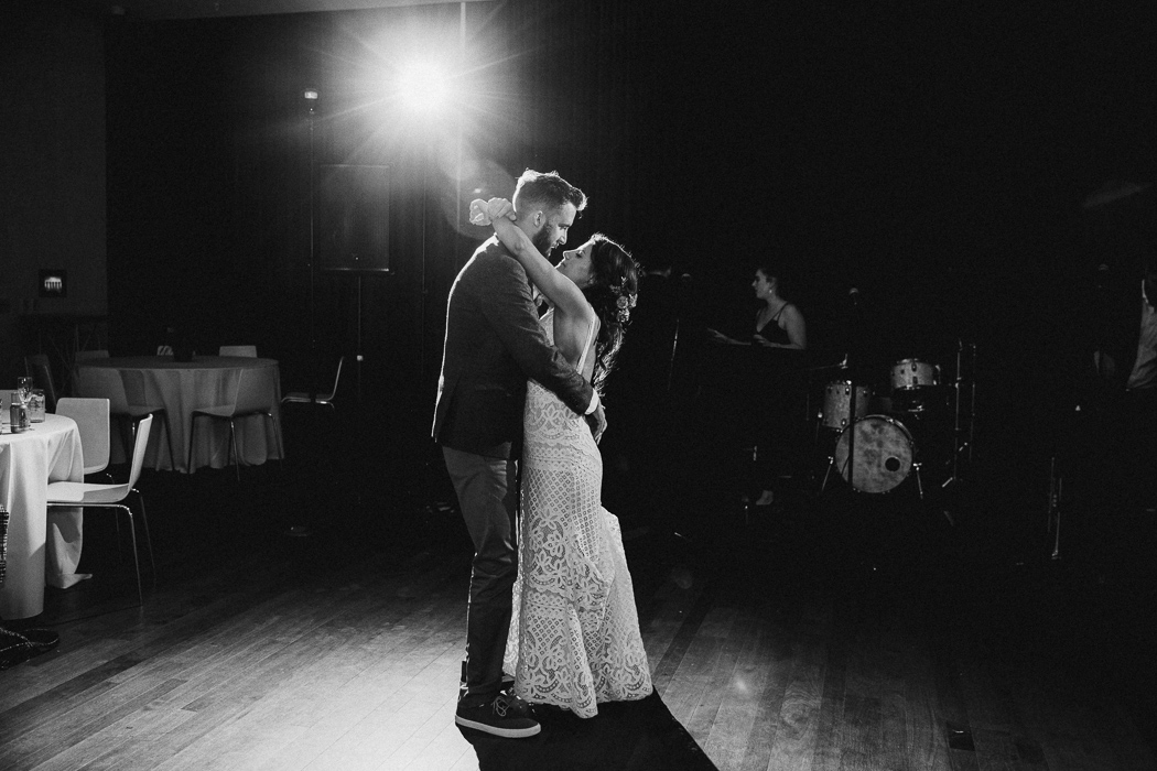 Bride and groom dancing on their wedding day to the last dance song with no one around them.