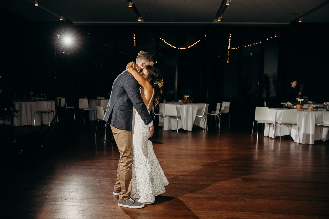 Bride and groom embracing doing their last dance at their wedding.