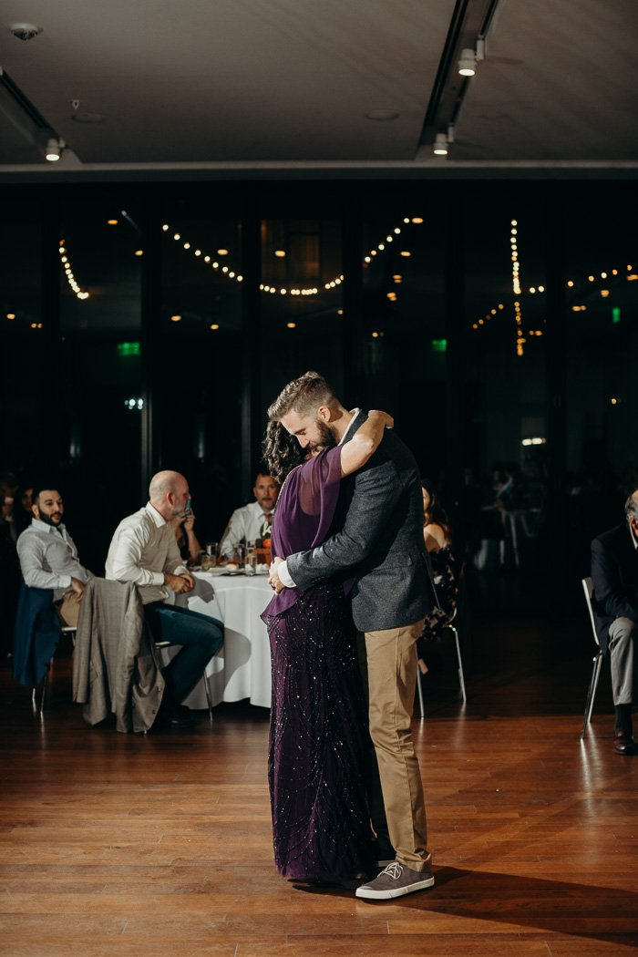 Mother and son dancing on the son's wedding day.