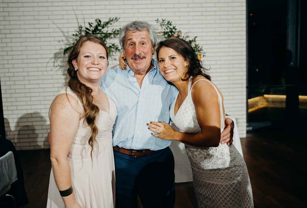 Father and his two daughters on one of his daughter's wedding day.