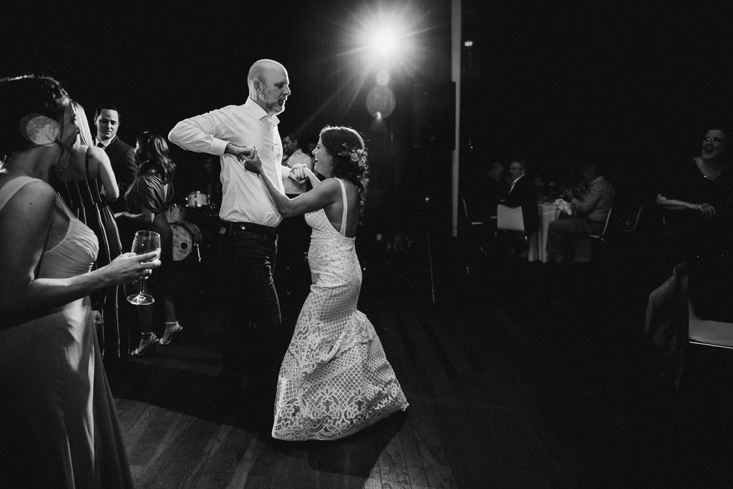 Bride dancing with a guest at her wedding.