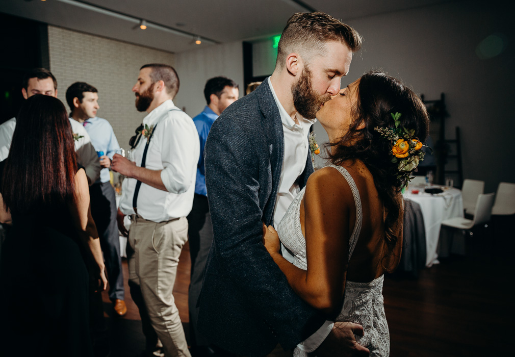 Bride and groom kissing in the middle of the dance floor at their wedding.