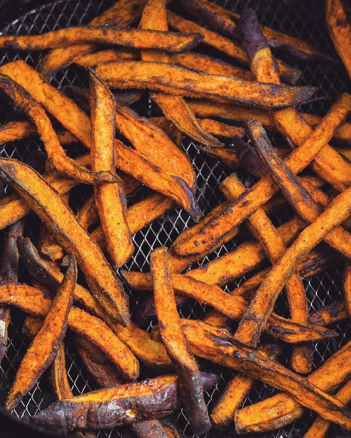 Overhead shot of sweet potato fries in the air fryer