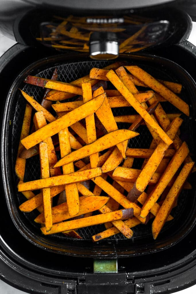 Raw sweet potato fries in an air fryer