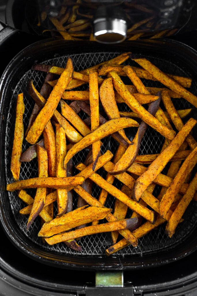 Partially cooked sweet potato fries in the air fryer