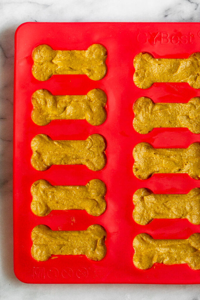 3 ingredient peanut butter dog treats in a bone-shaped silicone mold.