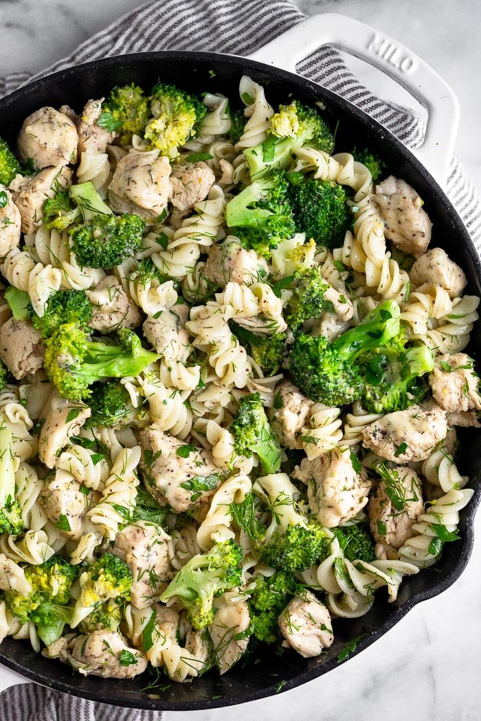Pan filled with chicken ranch pasta with broccoli and lots of herbs.