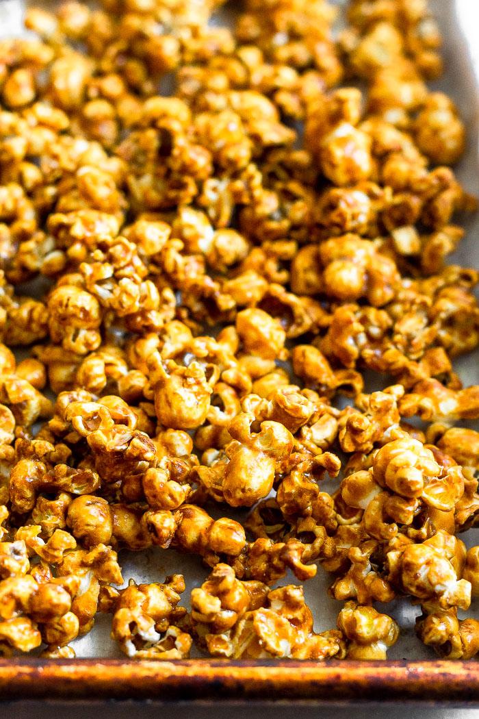 Baking sheet filled with easy caramel popcorn