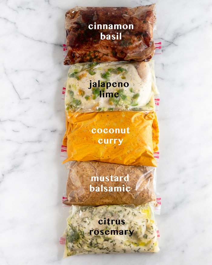 Five different Whole30 chicken marinades in plastic bags with text over each saying what they are.