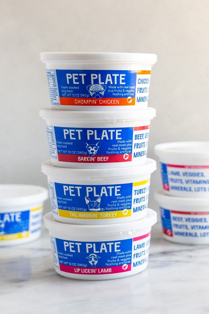 Pet Plate containers stacked on top of each other.