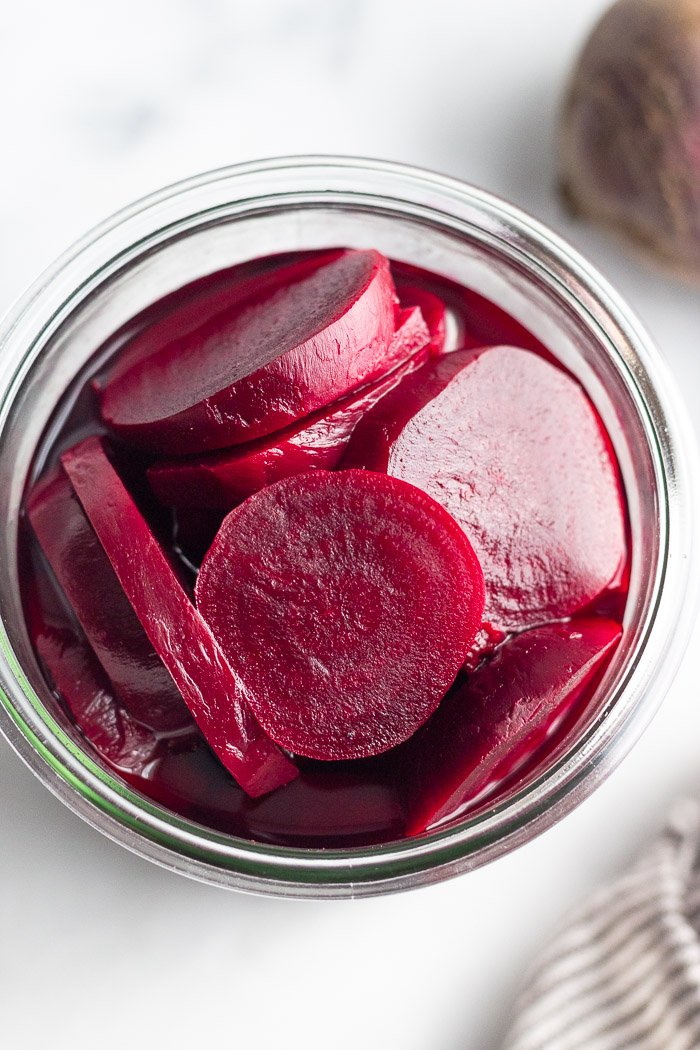 Overhead shot of quick pickled beets in a jar.